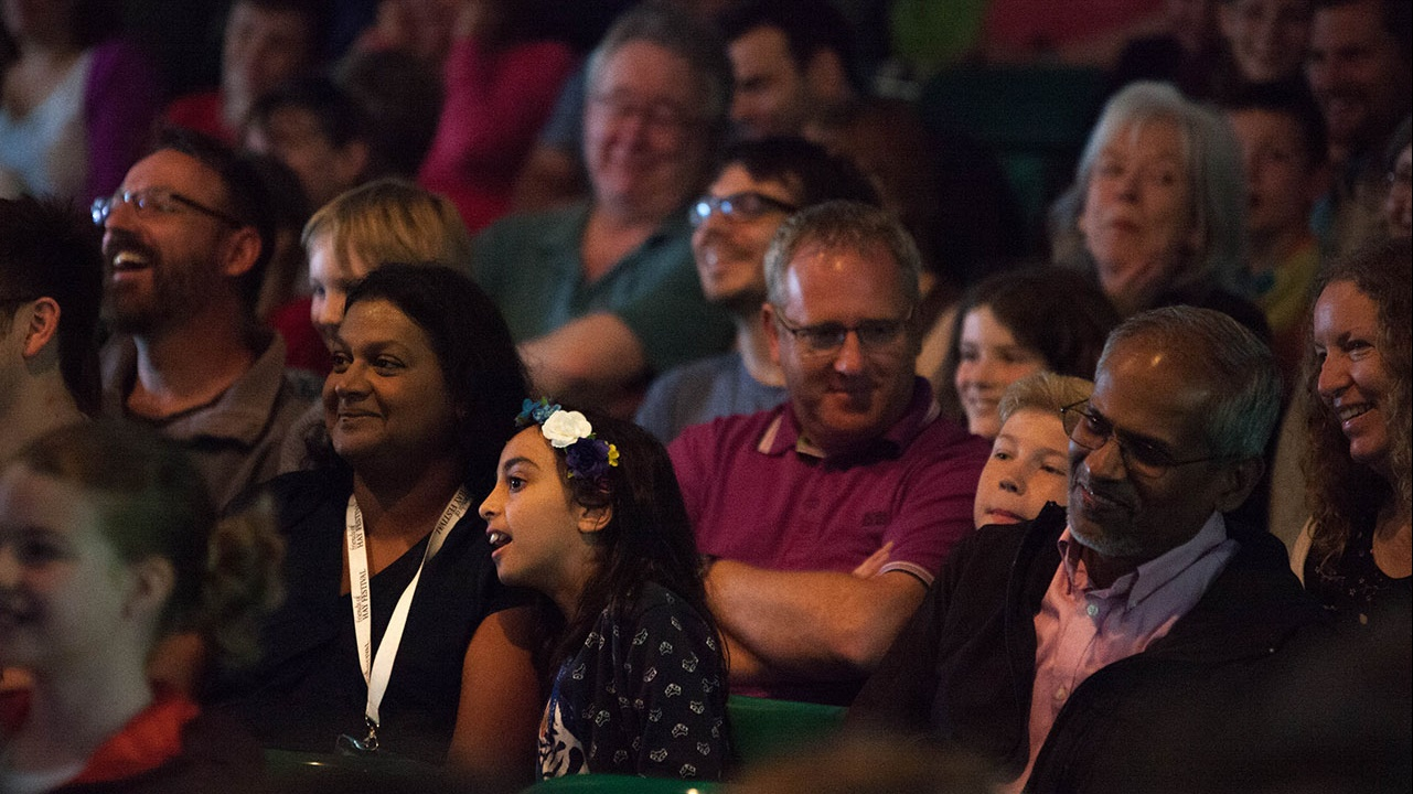 Smiling audience members