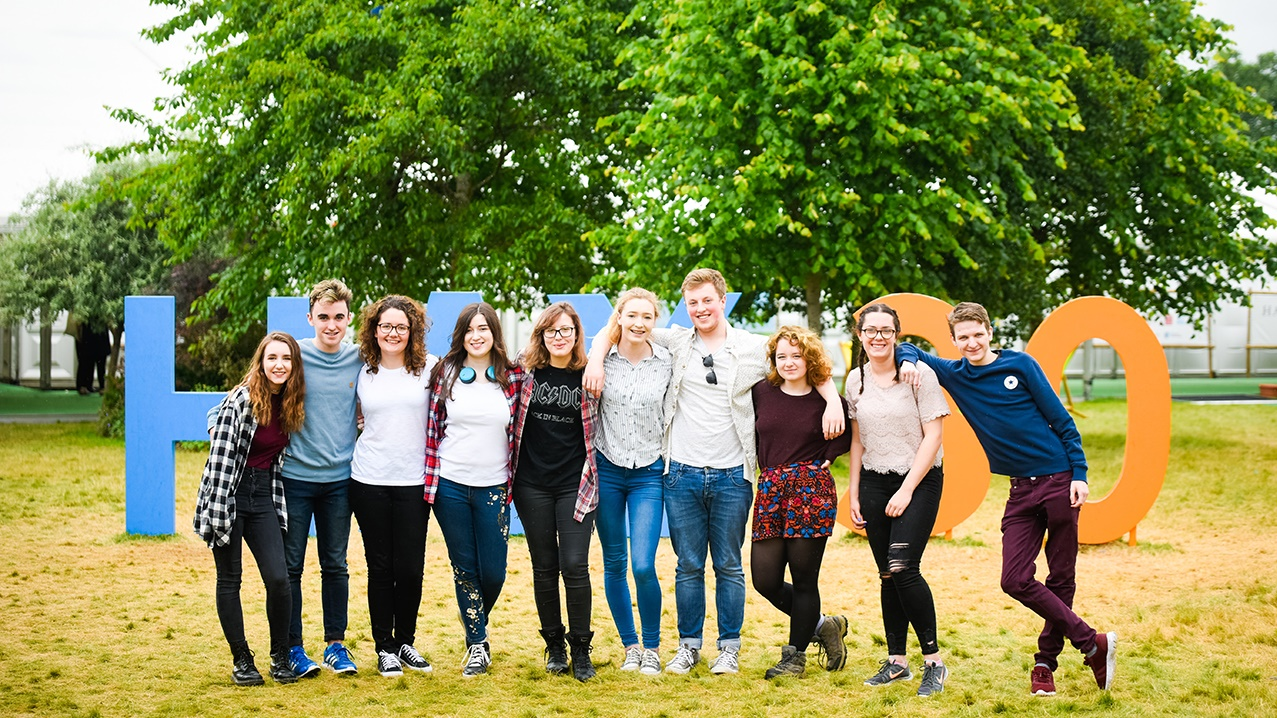 Group of students with Hay Festival sign
