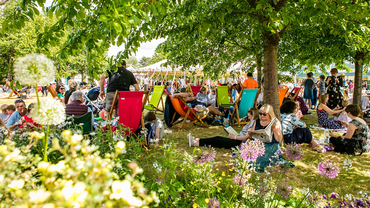 People sitting on the grass at Hay Festival
