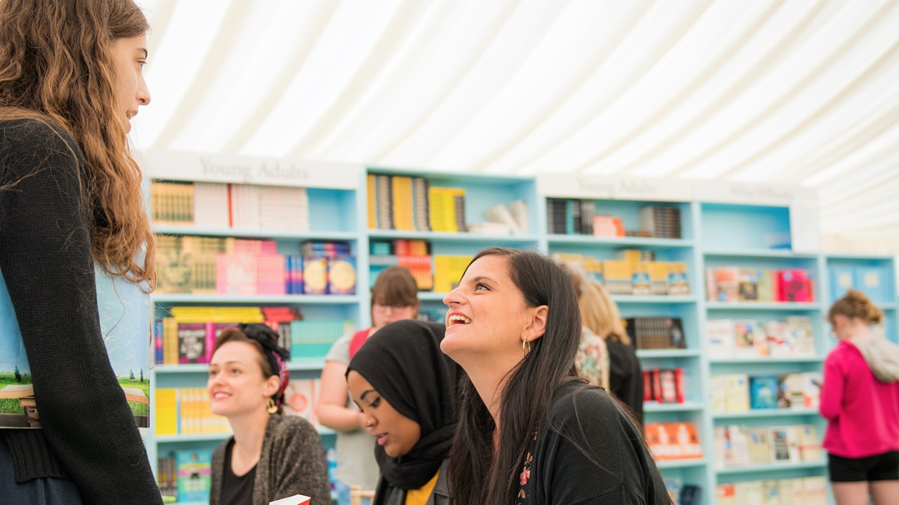 Girl speaking to author at Hay Festival