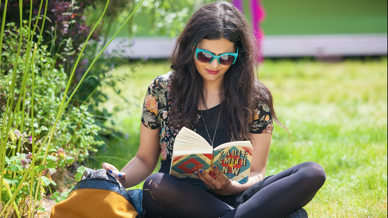 Girl reading at Hay Festival