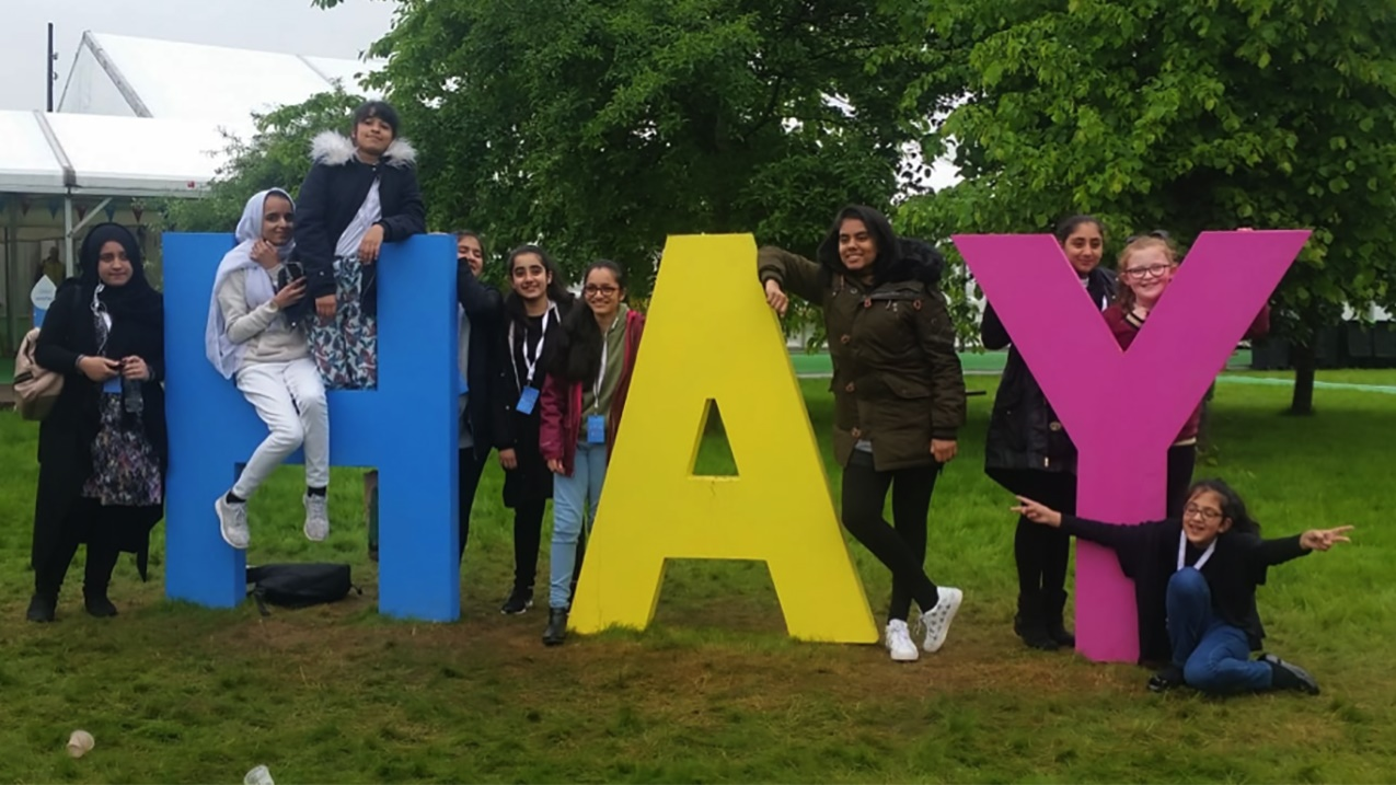 Bradford exchange pupils with HAY sign at Hay Festival