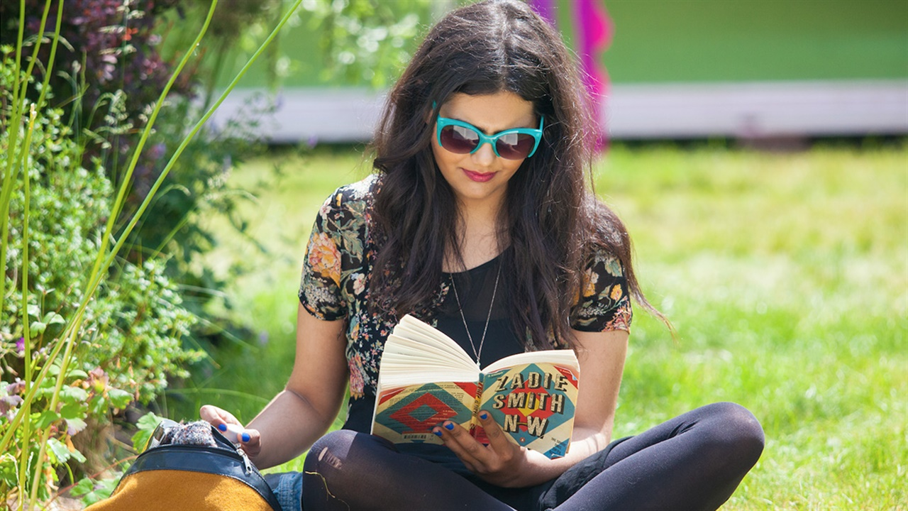 Young woman reading at Hay Festival