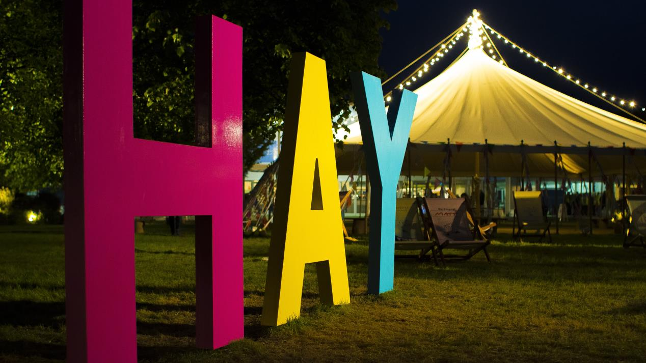 Hay Festival sign by night