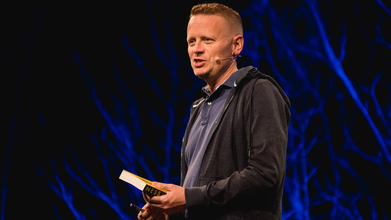 Patrick Ness on stage at Hay Festival