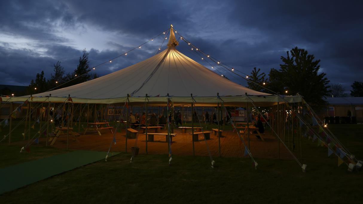 A Hay Festival tent at night