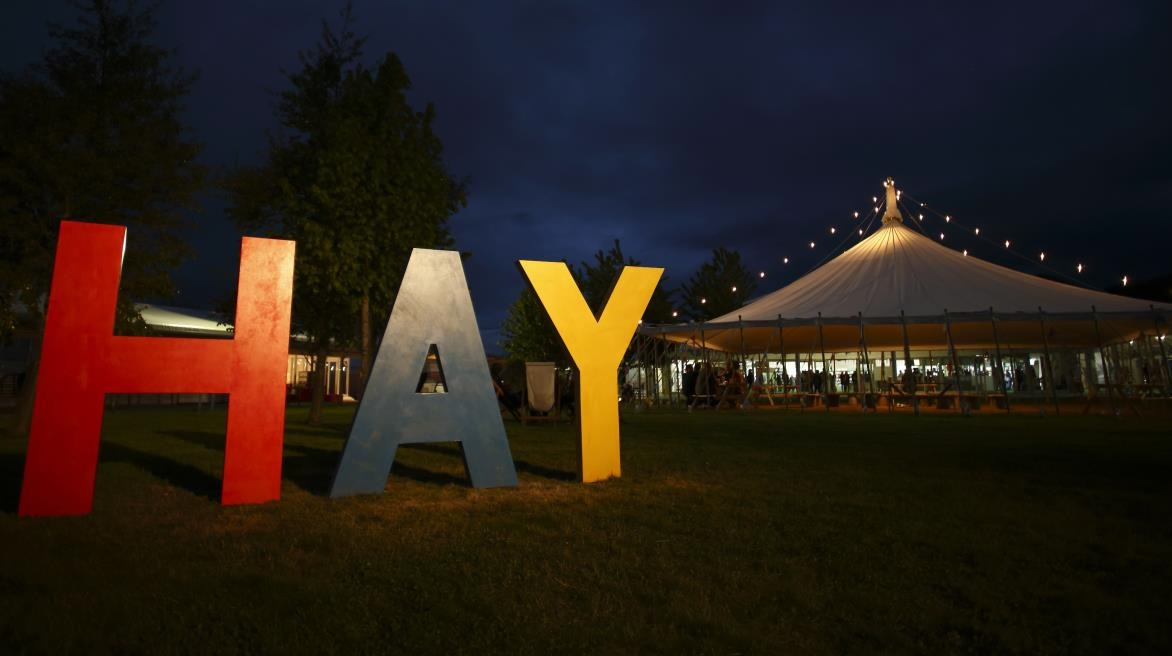 Hay Festival sign lit up at night