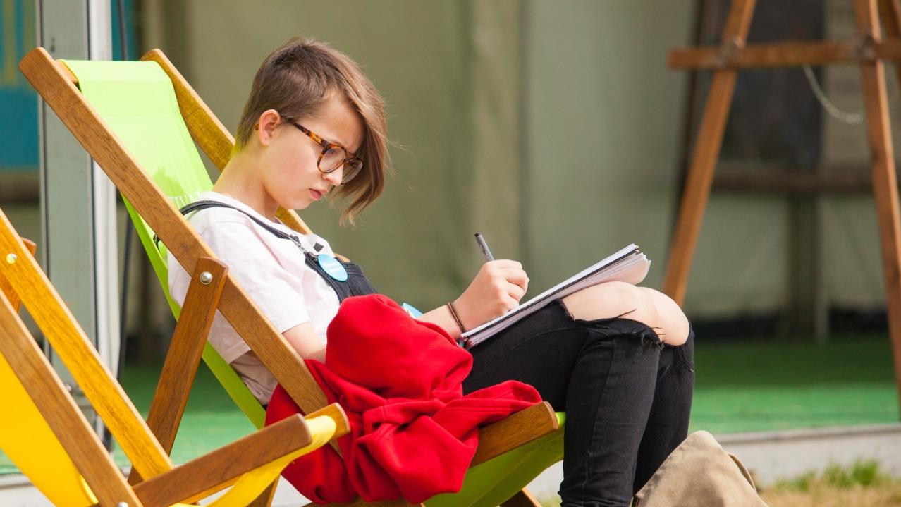 Writing in deckchair